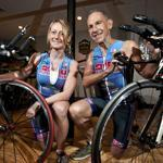 Kathy Laska and her father, Dave Wilson, with their triathlon bikes that they will ride up a volcano on the Big Island of Hawaii.
